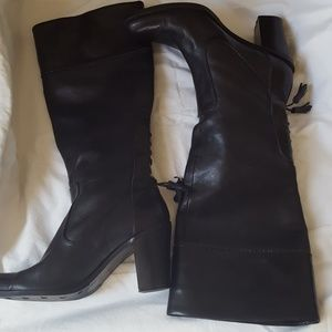 Tall black boots with tassle on back